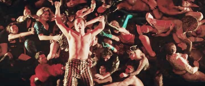 Rocketman Orgy Scene: ROCKETMAN is an epic musical fantasy about the incredible human story of Elton John's breakthrough years. The film follows the fantastical journey of transformation from shy piano prodigy Reginald Dwight into international superstar Elton John.