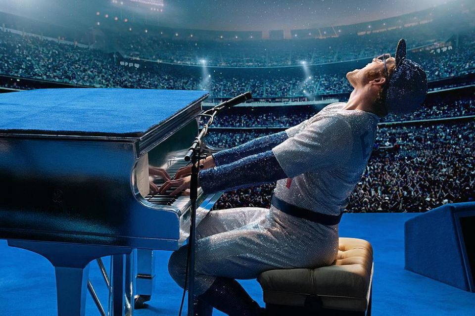 "Elton John Biopicture ""Rocketman"" played by Taron Egerton. ROCKETMAN is an epic musical fantasy about the incredible human story of Elton John's breakthrough years. The film follows the fantastical journey of transformation from shy piano prodigy Reginald Dwight into international superstar Elton John."