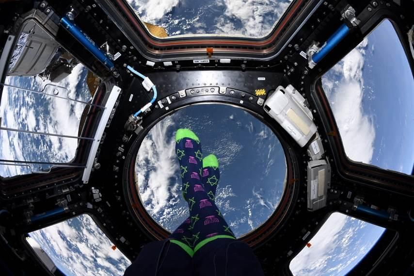 "NASA astronaut Jessica Meir tweeted out her holiday wishes from the International Space Station (ISS) alongside a photo of her purple menorah and green Star of David socks. ""Happy HANNUKAH 2019!"