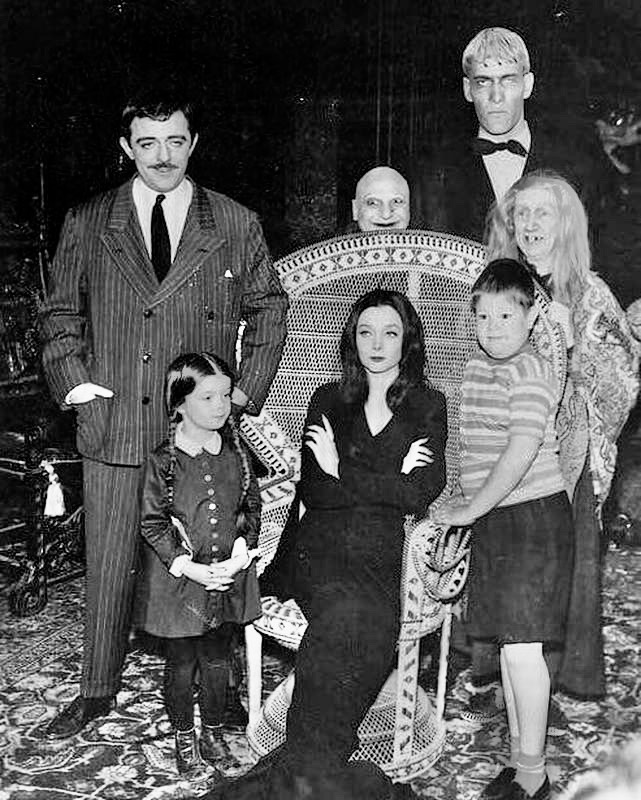 Candid pose of The Addams Family during a photo shoot in 1964