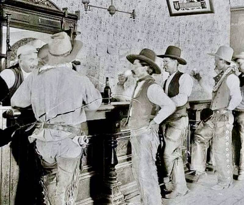 Cowboys getting drinks at a saloon in Tascosa Texas. 1907 1