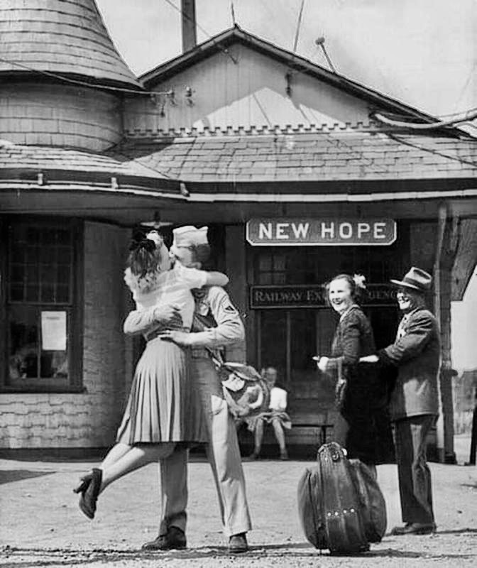 Couple reuniting after WWII. Behind was a sign with New Hope written on it