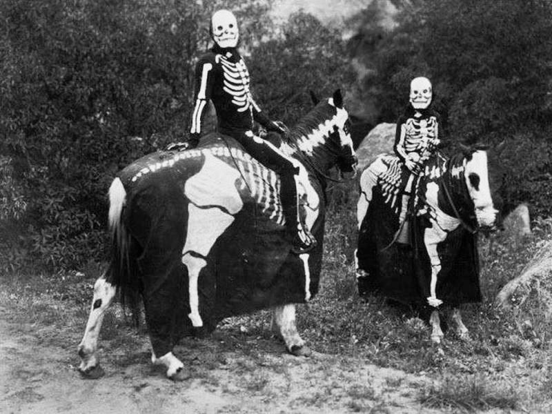 Some spooky skeletons riding horses for Halloween in the 1920s