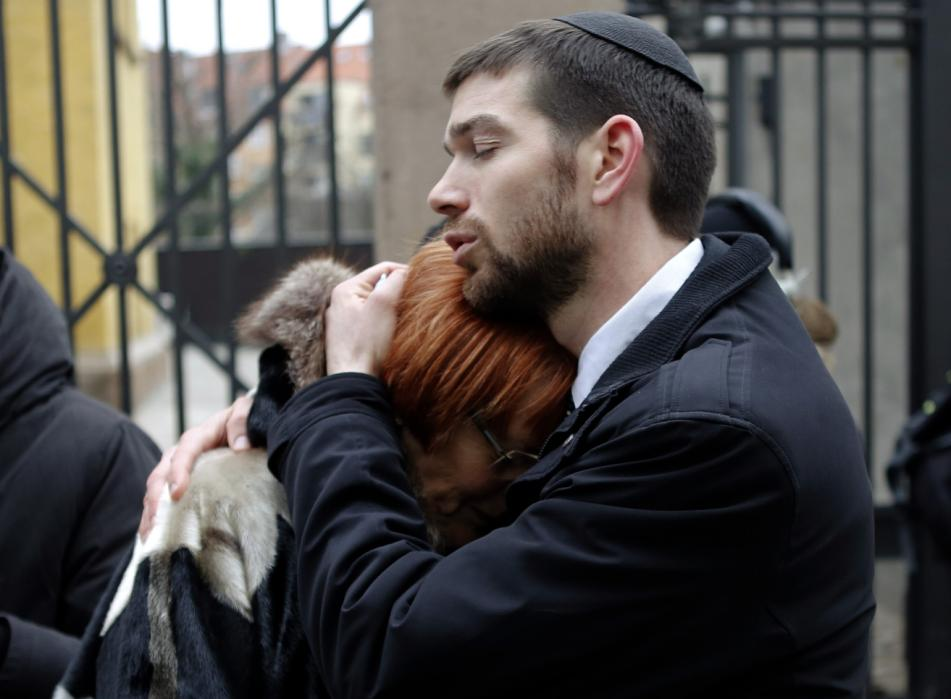 Denmarks_Chief_Rabbi_Jair_Melchior_Comforts_Woman_at_a_Memorial_Site_for_the_Victims