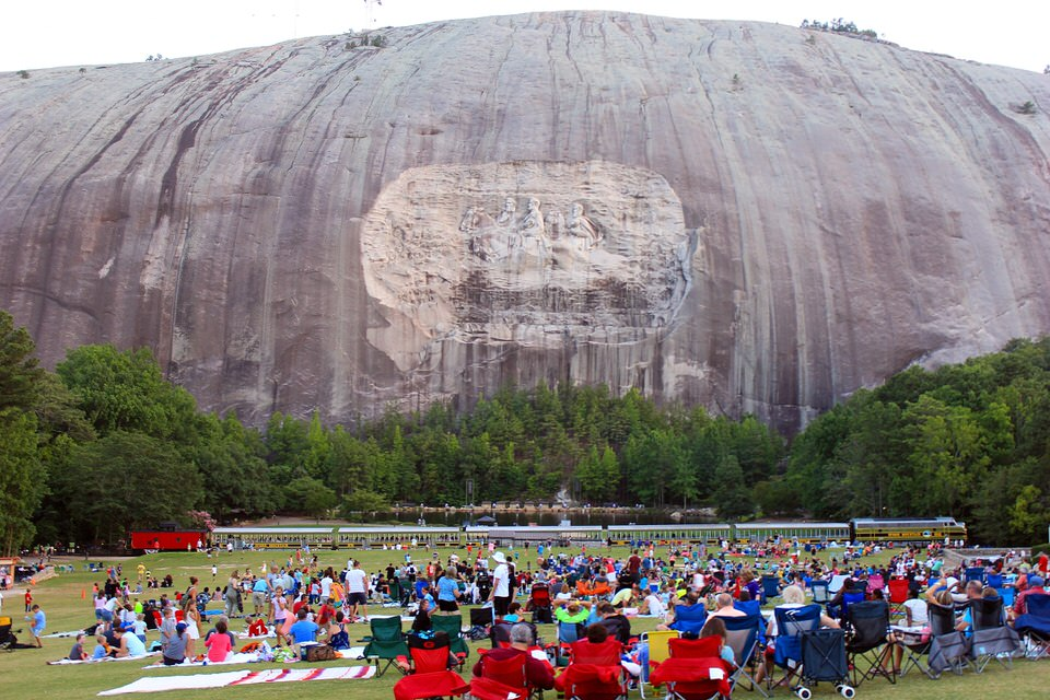 Mountain carving and train as visitors prepare to watch the nightly laser light show 1