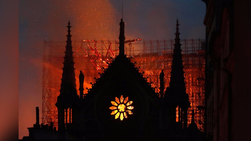 Front of Notre Dame with fire behind