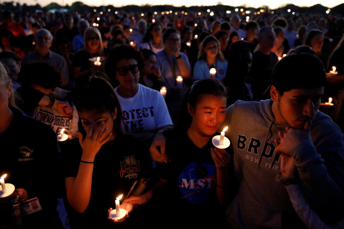 people attend a candlelight vigil for victims of the shooting at nearby marjory stoneman douglas high school in parkland florida