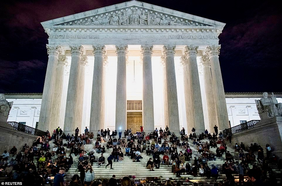 In the steps of the Supreme Court singing Amazing Grace
