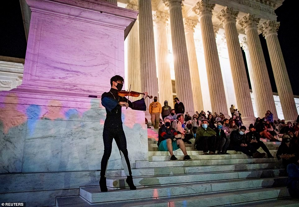 a man plays violin outside of USSC