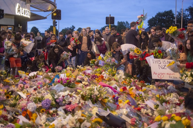 PEOPLE PAYING RESPECTS TO THE VICTIMS IN NEW ZEALAND