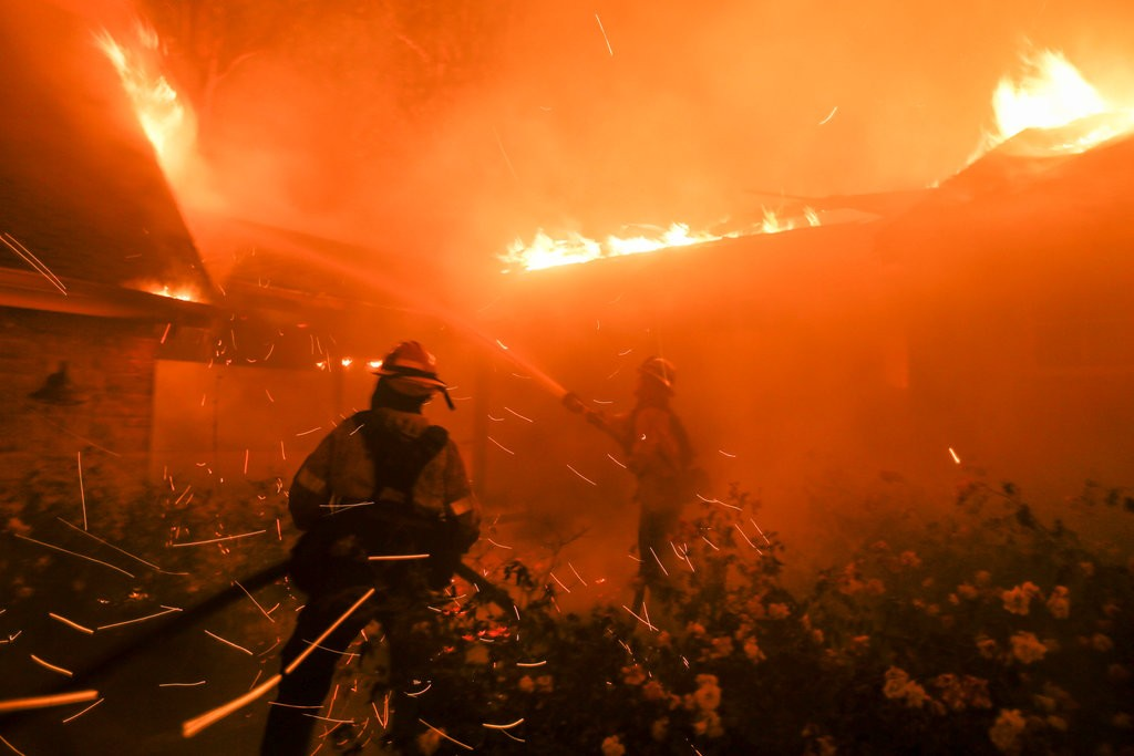 Firefighters battling Malibu Fires in California