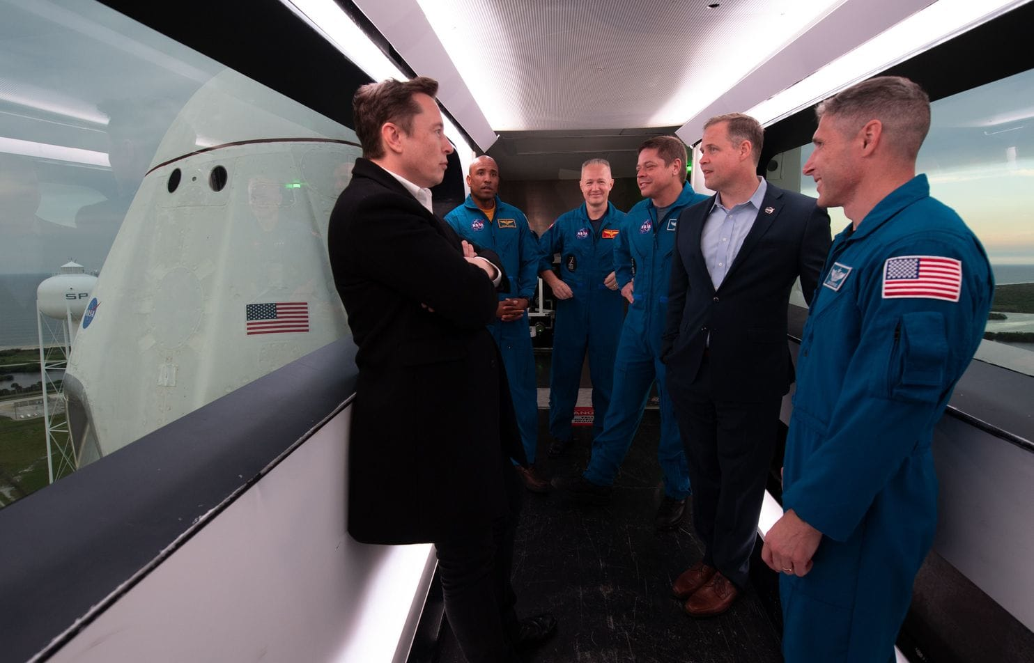 Elon Musk with Austronauts and NASA executives