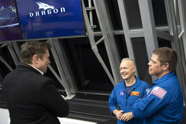 Elon Musk with astronauts Doug Hurley and Bob Behnken who are scheduled to make the first crewed flight