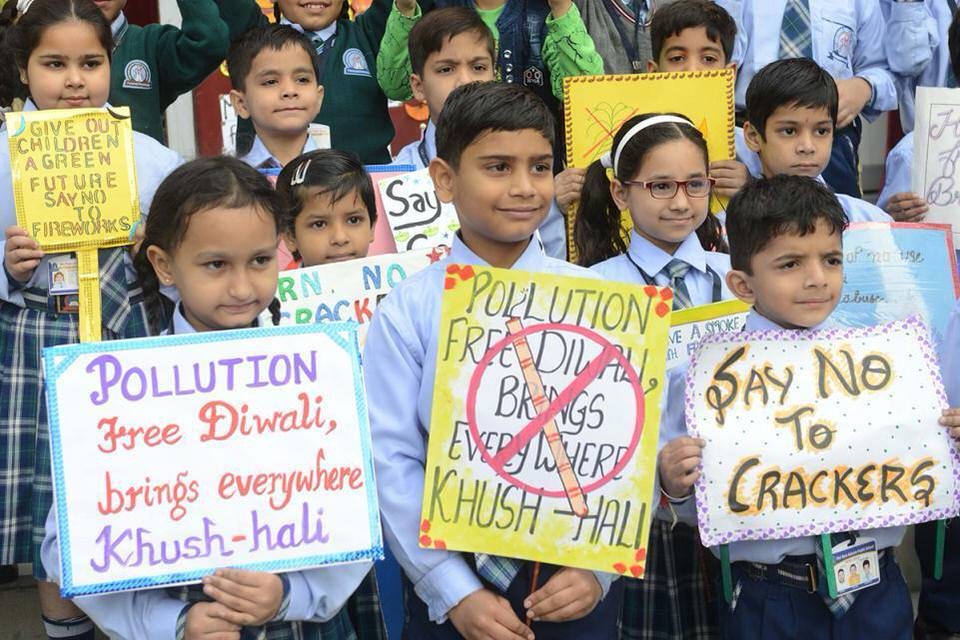 Indian school children hold placards as they stage a demonstration against the use of fireworks and crackers to avoid air pollution during Diwali 1