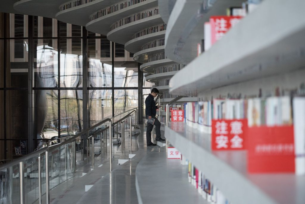 Man Walks Up one of many staircases of the Library
